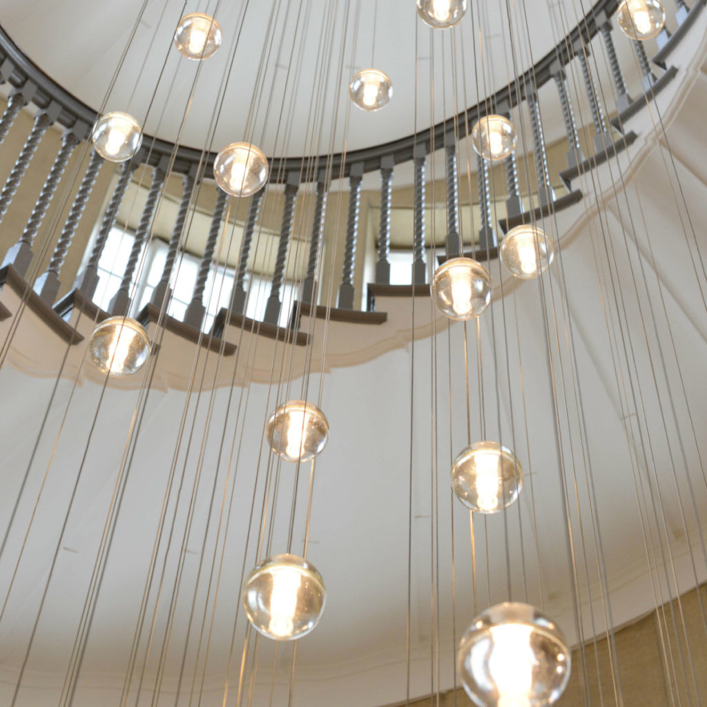 14 Series Pendant. The iconic light is  shown here hanging in the Brewer Staircase at the Heal's store on Tottenham Court Road