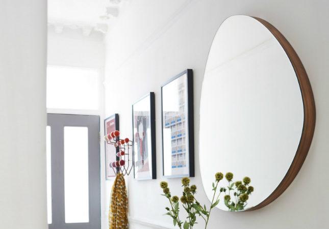 Orta Round Mirror on a hallway wall