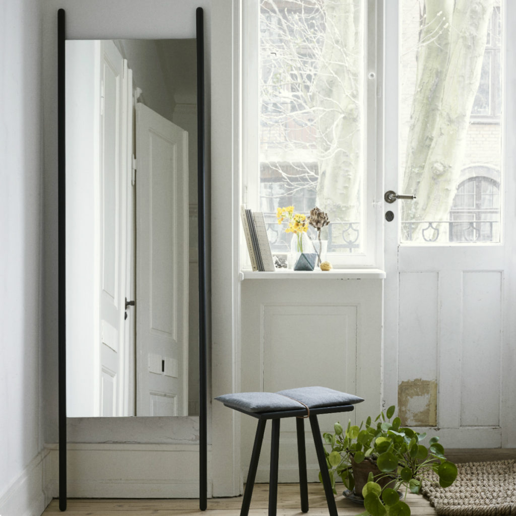 Georg Mirror reflects the natural light that makes a small space feel larger
