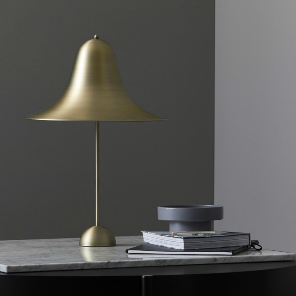 The iconic Pantop Table Lamp in antique brass