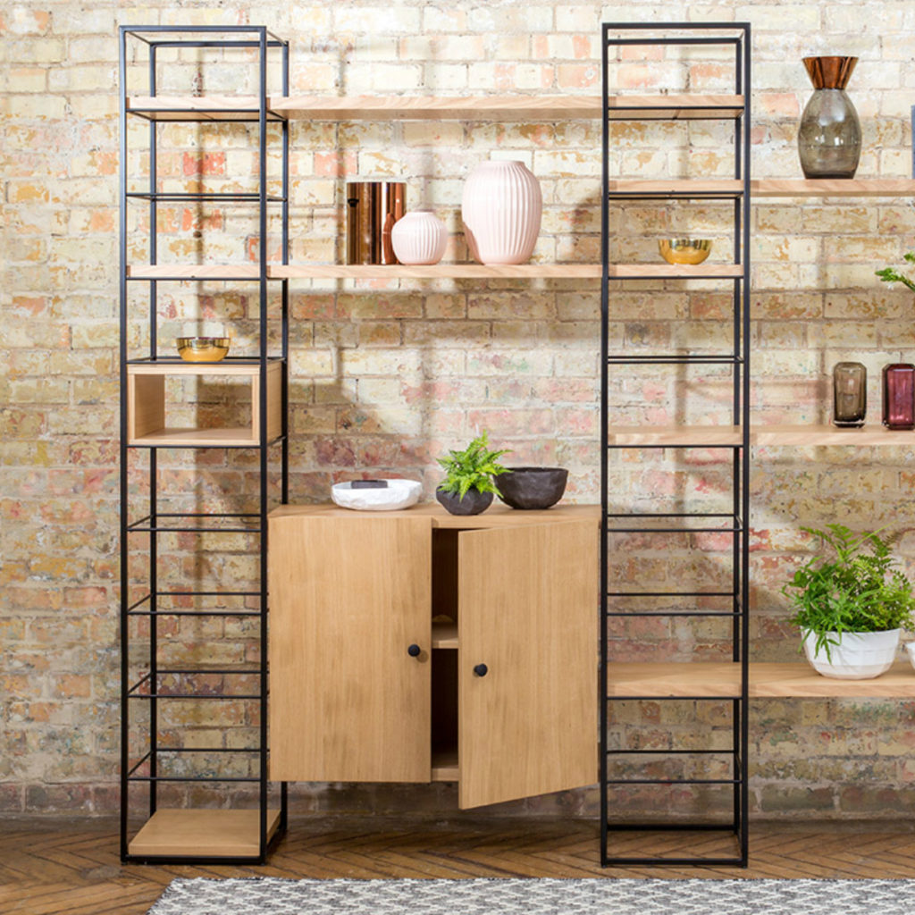 Tower Shelving Unit on a brick wall - ideal for storage in a small space