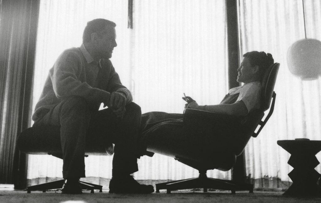 Charles and Ray Eames on an Eames Lougne Chair | Image courtesy of Vitra