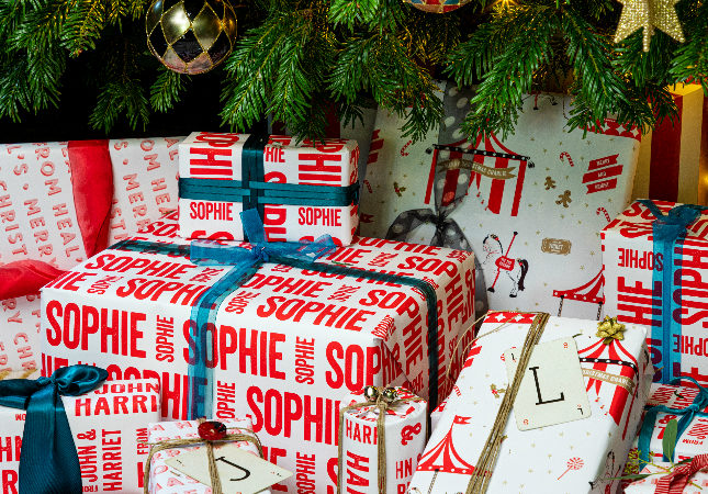 Presents under the Christmas tree with personalised paper