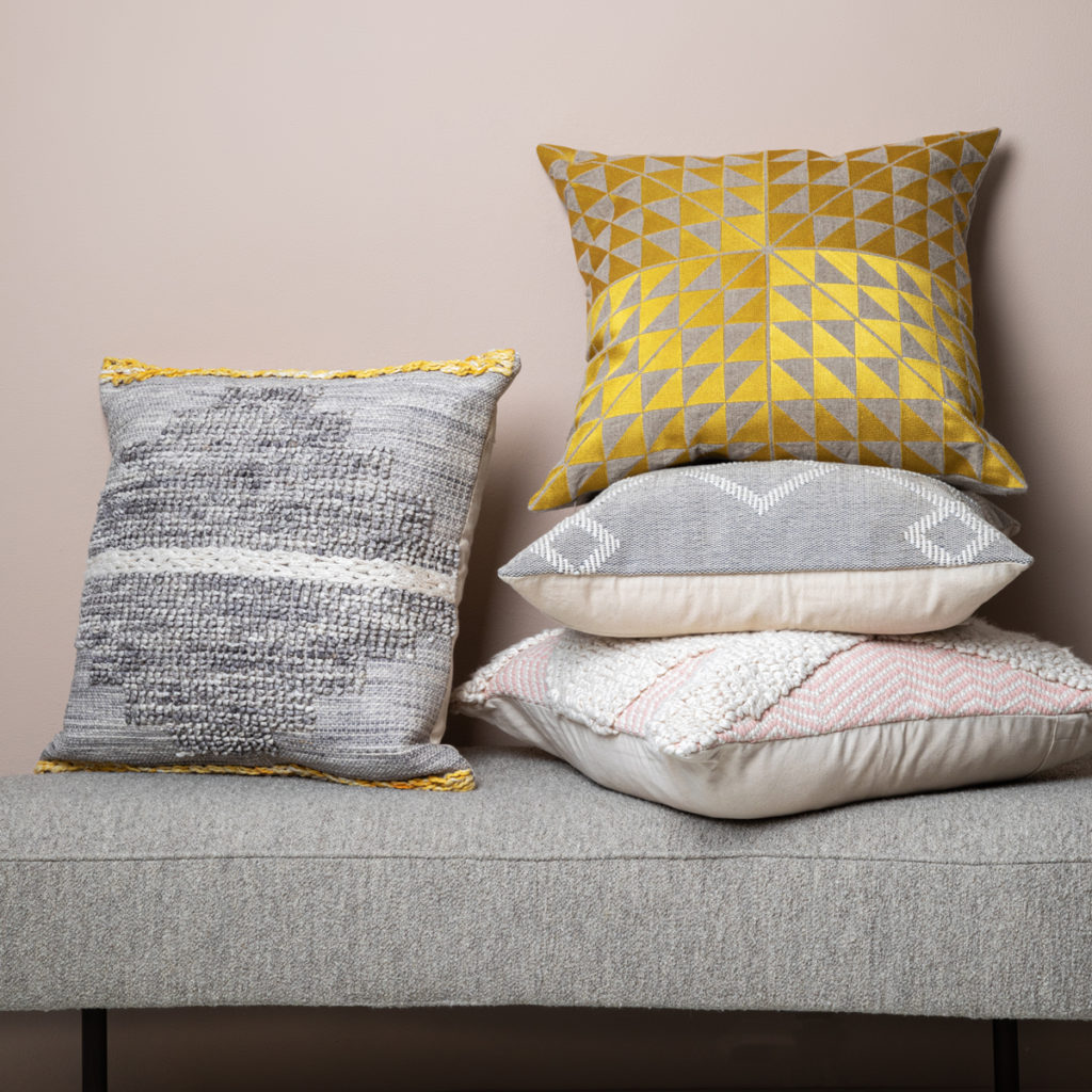 Use cushions to enliven a rental property sofa