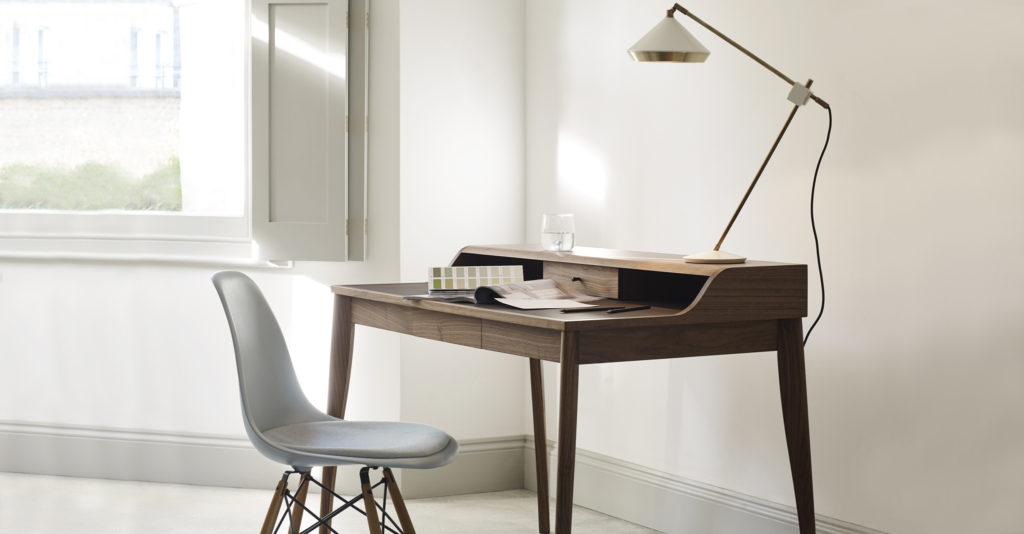 An Eames Plastic Chair as a desk chair in a home office