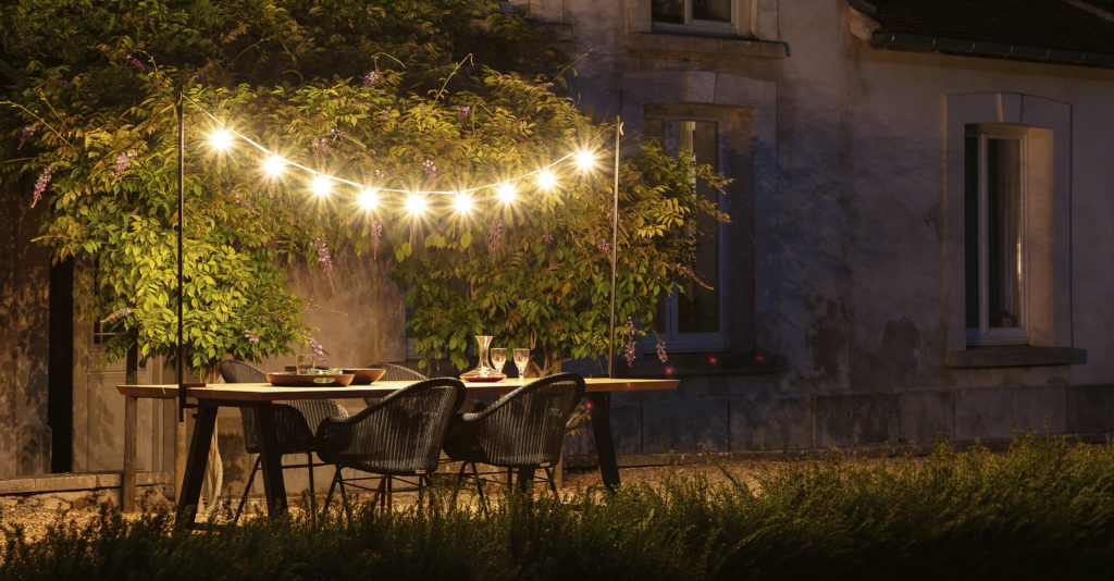 Vincent Sheppard Light My Table in a garden dining space