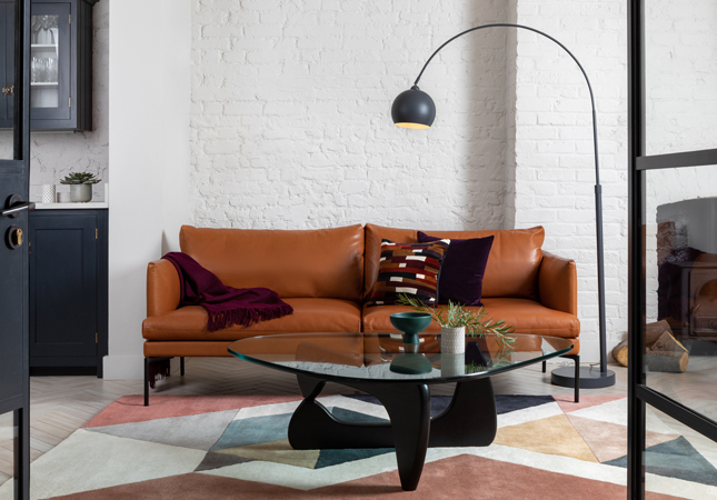 Leather-upholstered Matera Sofa in a modern, industrial room
