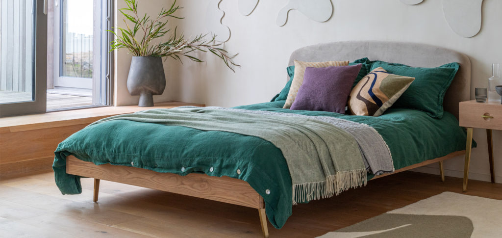 Crawford Bed with green colour bedsheets
