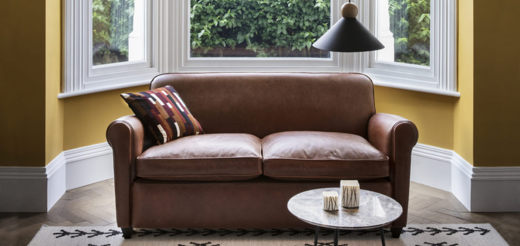 Barrington Brown Leather Sofa with yellow walls