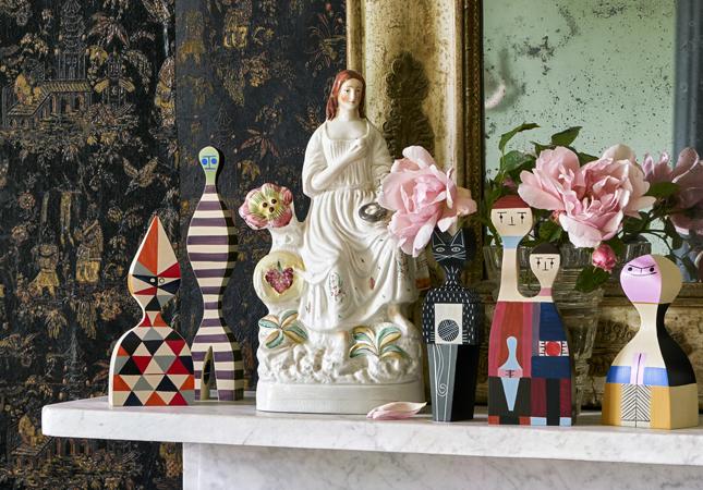 Girard Wooden Dolls on a mantelpiece