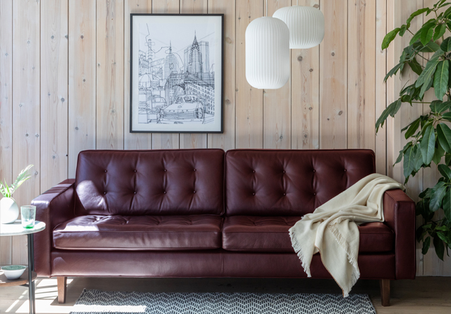 Hepburn brown leather sofa in a wood-panelled room