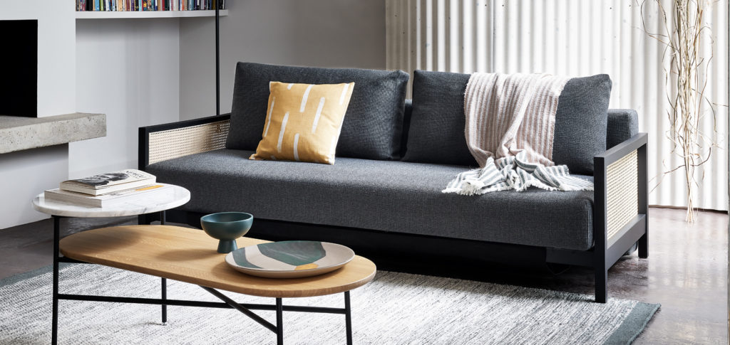 Cane Sofa with grey upholstery in a living room