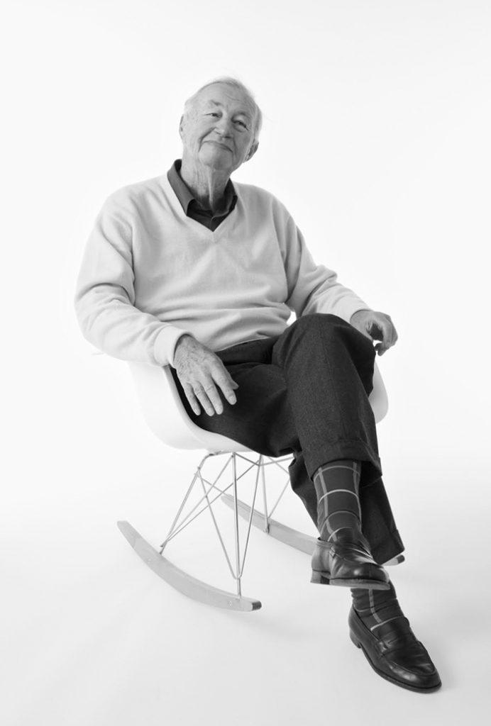 Sir Terence Conran on an Eames Chair